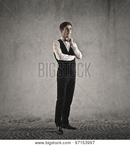 Elegantly dressed man standing