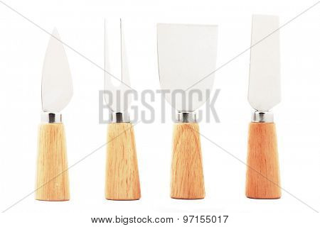 Set of cheese knives and fork, isolated on white background
