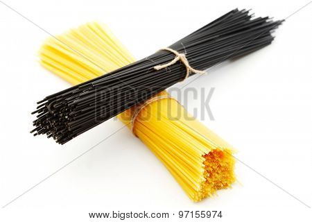 Black and white dry spaghetti isolated on white background