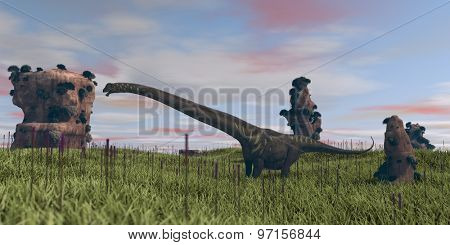 mamenchisaurus waking on grassy planr with cliffs