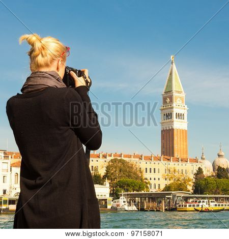 Female tourist taking photo of Venice.