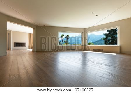 Architecture, wide living room with windows, parquet floor