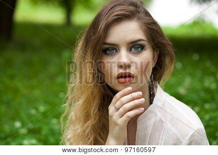 Close up portrait of a beautiful brunette woman, outdoors