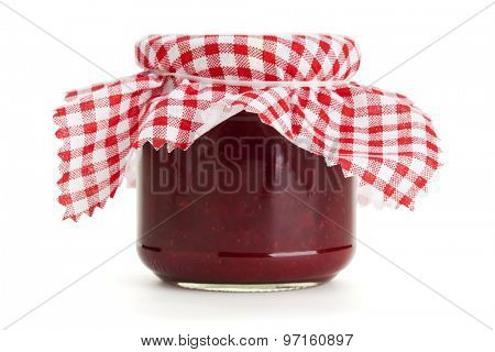 Jar of red jam with checkered cloth on top, isolated on white background