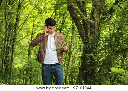 Young man hiking in lush green mountain scenery
