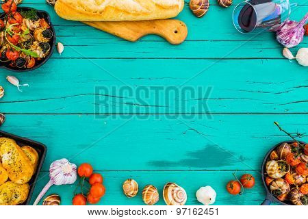 Baked escargot in butter with herbs and tomatoes, frame with space for text