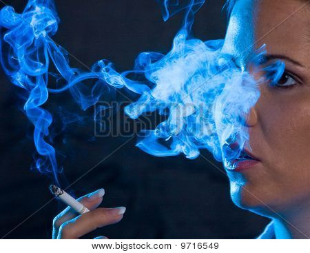 Woman Smokes A Cigarette