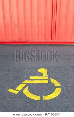 Disability Priority Sign For Wheelchair Using On Concrete Steet And Corrugated Painted Wall.