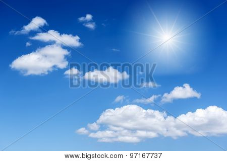 Blue sky and cloud with bright sun star flare background.