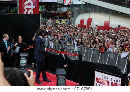 NEW YORK-JUL 27: Actor Tom Cruise waves to the crowd at the US Premiere of 'Mission: Impossible - Rogue Nation' in Times Square on July 27, 2015 in New York City.