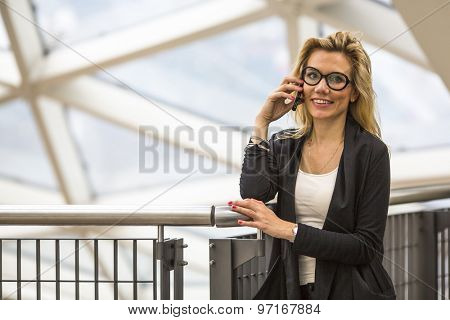 Attractive business woman talking on mobile phone.