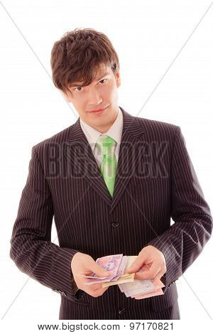 Smiling Young Man In Striped Suit And Tie Holds Banknotes