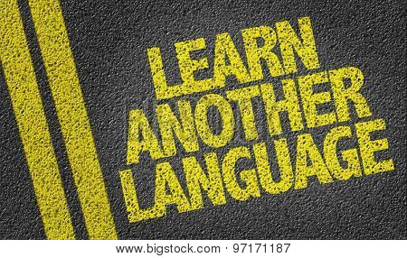 Learn Another Language written on the road