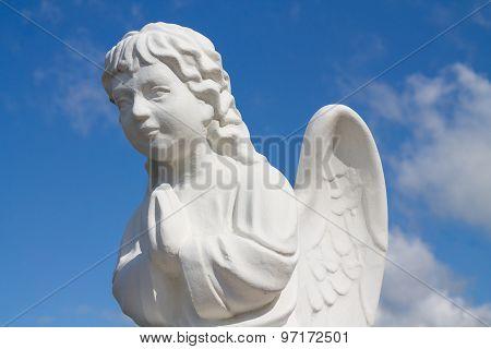 Statue of a praying angel