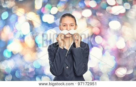 Young woman dressed up in suit and wearing fake mustache