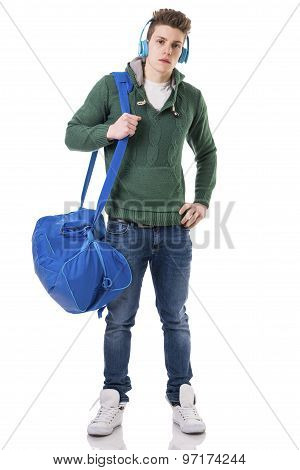 Attractive young man with bag on shoulder strap and headphones