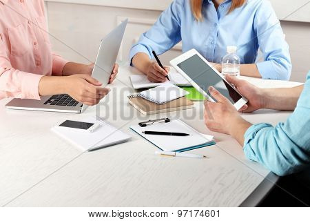 Work process of business meeting with electronic devices in office