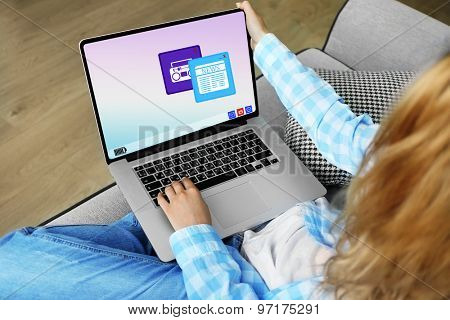 Woman using laptop, indoors