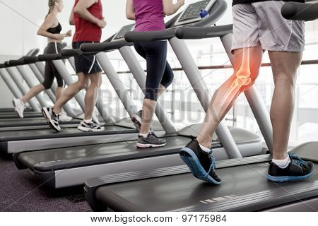Digital composite of Highlighted knee of man on treadmill