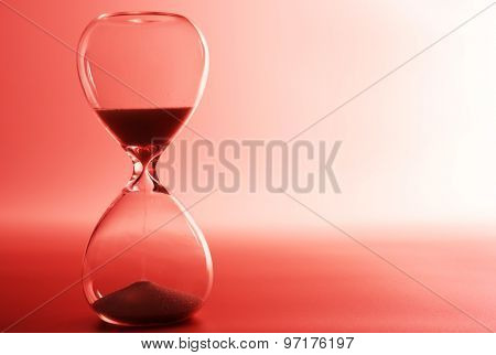 Hourglass on pink background