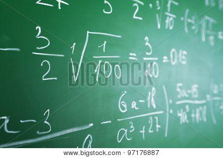 Formulas on blackboard close up