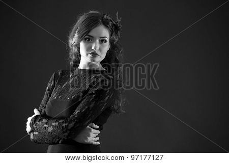 Retro style portrait of pretty woman in shades of grey