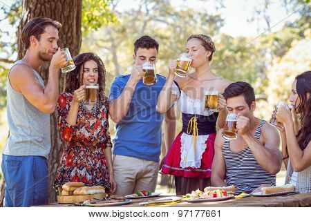 Friends drinking in the park on a sunny day
