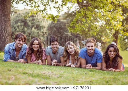Friends lying and talking in the park on a sunny day