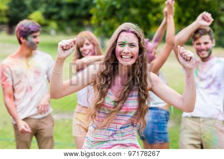 happy friends covered in powder paint on summer day