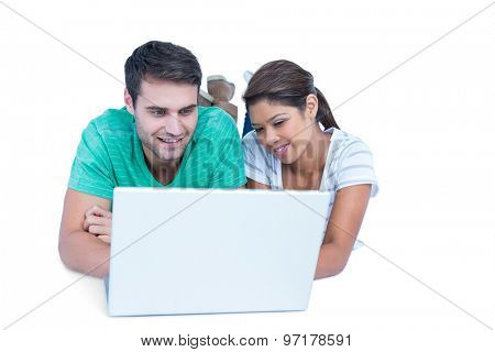 Couple looking at laptop computer on white background