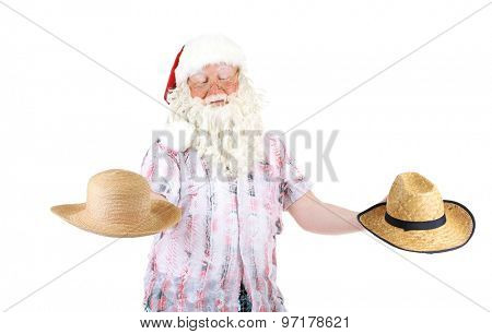 Santa Claus holding two straw hats , isolated on white