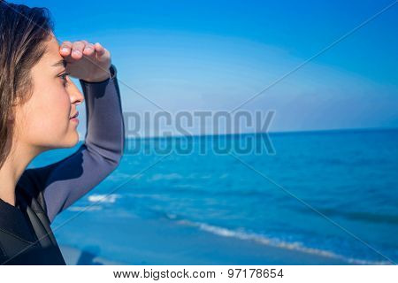 Woman in wetsuit on a sunny day at the beach