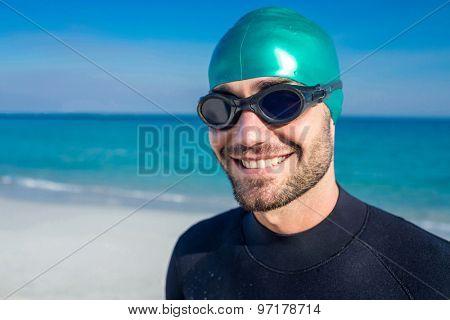 Swimmer getting ready at the beach on a sunny day