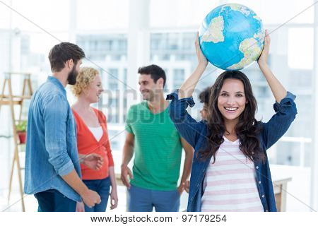 Young creative business people with a globe in the office