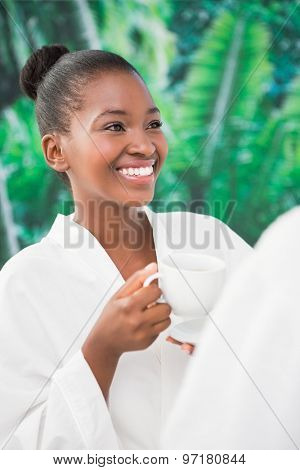 Close up of a beautiful young woman drinking coffee over white background