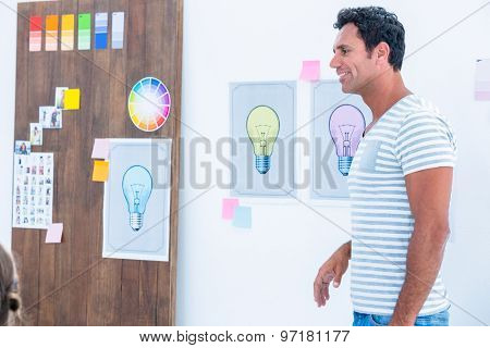 Creative man giving speech during a meeting at office
