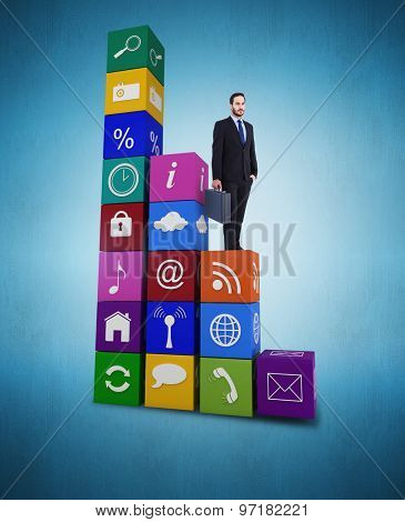 Focused businessman holding a briefcase against blue vignette background