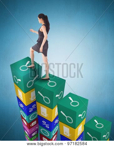 Businesswoman stepping up against blue vignette background
