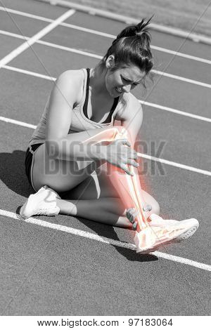 Digital composite of Highlighted bones of injured woman on track