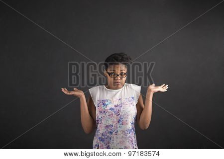 African Woman With An I Don't Know Gesture On Blackboard Background