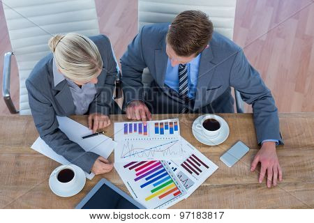 Business people brainstorming together in an office