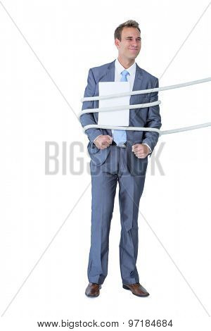 A businessman tie up by rope on white background