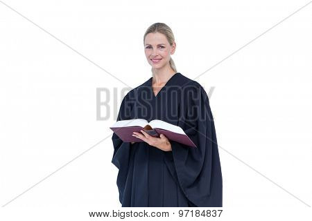 Happy pretty lawyer holding labor code on white background