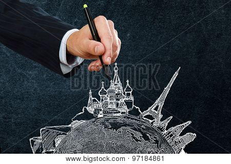 Businessman hand drawing dream travel around the world