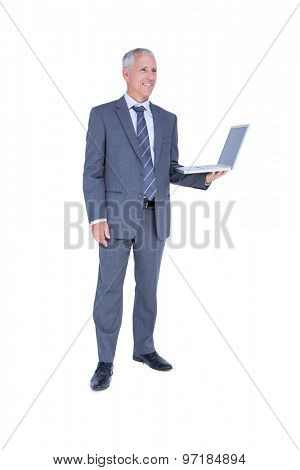 Happy businessman holding laptop computer on white background
