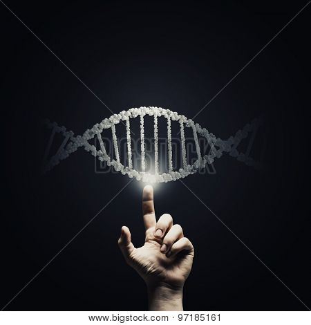 Science concept image of human hand touching DNA molecule