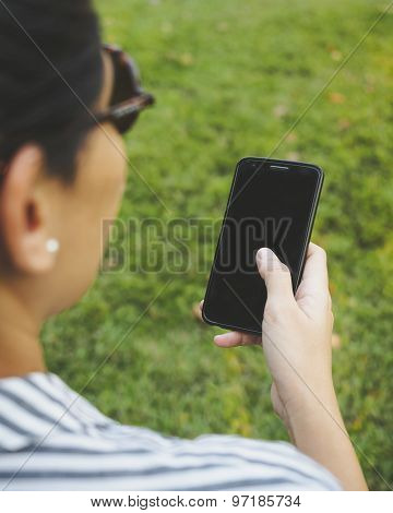 Woman Hand holding Mobile Smart phone