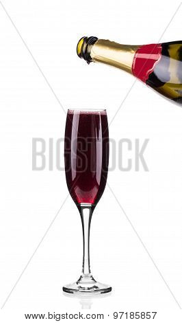 Glass full of red champagne