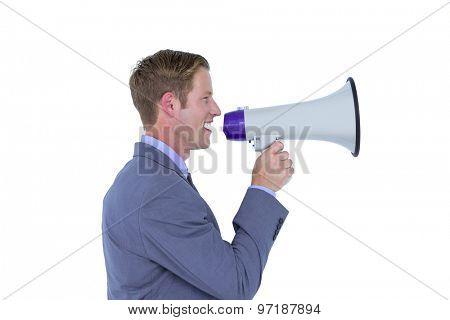 Handsome businessman talking through megaphone