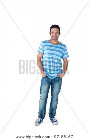 Smiling man with hands in pocket looking at camera on white background